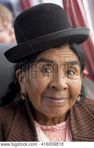 Copacabana, Bolivia, January 13 - 2015: Portrait Of A Bolivia Senior Woman Smiling At The Camera And