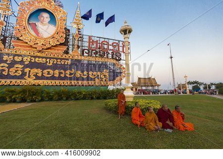 Phnom Penh, Cambodia - 28/01/2016:  Cambodian Buddhist Monks Sitting On The Grass In Front Of The Mo