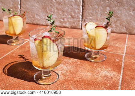 Fresh And Healthy Cocktail Or Mocktail With Apple, Ice, Cinnamon And Herbs. Refreshing Summer Drink.