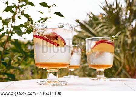 Fresh And Healthy Cocktail Or Mocktail With Apple, Ice, Cinnamon And Herbs. Refreshing Summer Drink
