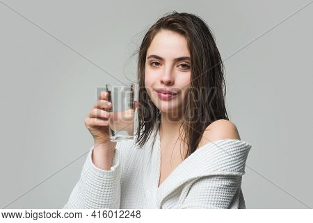 Woman Drinking Water Glass. Beautiful Woman, Female Skin Care, Close Up Face Beauty Portrait