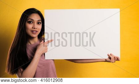 Young Pretty Woman With A Sign Dummy - Studio Photography