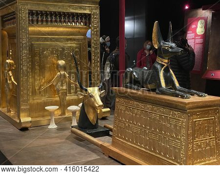 Exhibition Of Tutankhamun In Zurich During Pandemic Time. Tomb And Treasures With Golden Cow And Bla