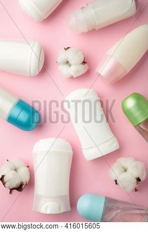 White Deodorants With Cotton On Pink Background. Top View.