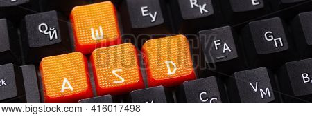 Orange Arrow Keys On A Black Keyboard, Up, Down, Left, Right Buttons On A Gaming Computer Keyboard