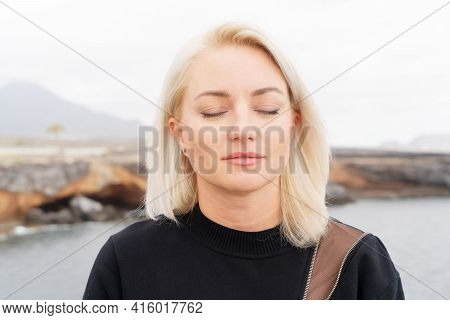 Blond Relaxed Girl Breathing And Calming Down, Happy Life And Relaxation Concept