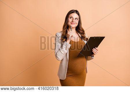 Portrait Of Pretty Creative Minded Cheerful Pregnant Girl Writing Idea Clipboard Deciding Isolated O