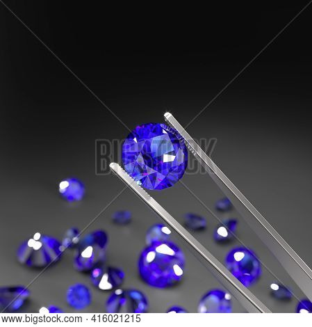 Tweezers Holds A Blue Sapphire. A Scattering Of Sapphires On A Black Surface. Gemstone Industry. Exp