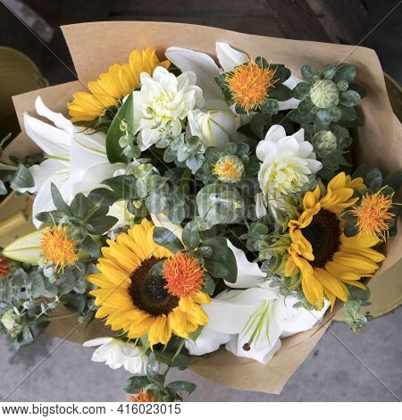Wedding Bouquet Of Sunflowers, White Chrysanthemum, Lilies, Eucalyptus And Marigold Wrapped In Craft