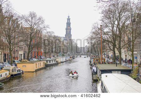Prinsengracht With Westerkerk In Amsterdam