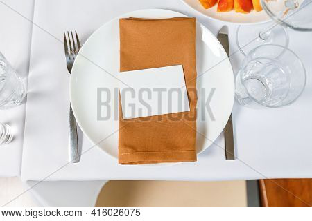 Wedding Table Setting With Blank Guest Card, Napkin, Succulent And Dish On A Wooden Plate. Rustic De