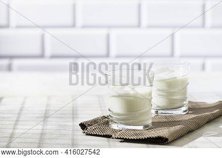 Fermented Drink Kefir, Yogurt In A Glass Jar On A Light Background. Probiotic Cold Fermented Dairy D