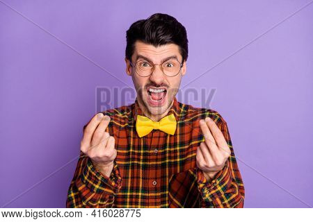 Photo Of Aggressive Crazy Guy Open Mouth Yell Hold Fingers Wear Bow Tie Plaid Shirt Isolated Purple