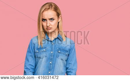 Beautiful caucasian woman wearing casual denim jacket skeptic and nervous, frowning upset because of problem. negative person.