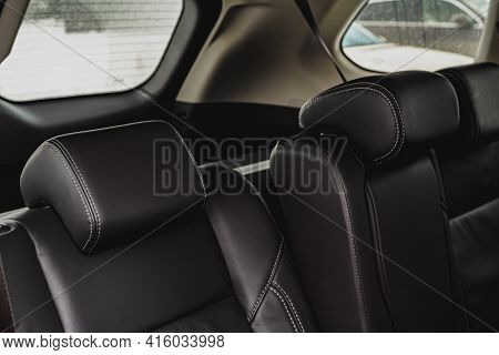 Black Leather Car Seats Close Up View. Modern Car Interior Details. Leather Headrest.