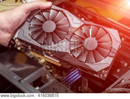 Installing Video Card In An Open Case Of Personal Computer. Graphics Adapter Or Graphics Card In The