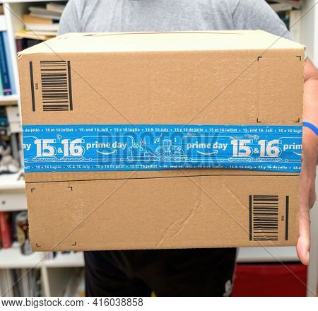 Paris, France - Oct 10, 2019: Senior Hands Holding New Amazon Prime Parcel Logotype With The Smiling