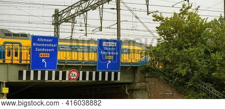 Haarlem, Netherlands - Aug 28, 2019: Fast Dutch Train Passing On The Bridge With Guidance Signage St