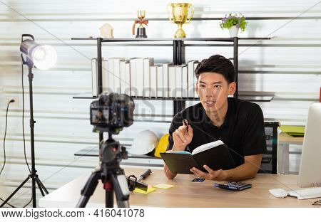 A Young Asian Man Works Online From Home. He Earns Money By Teaching Through Live Broadcasting Throu