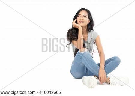 A Young Asian Woman Wore A Casual Dress On The Floor. She Looks At The Copy Space. She Daydreams. Is
