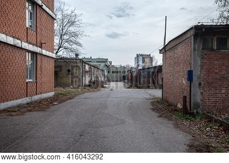 Abandoned Factories And Warehouses In Red Brick, With Broken Windows And Crumbling Walls In Eastern