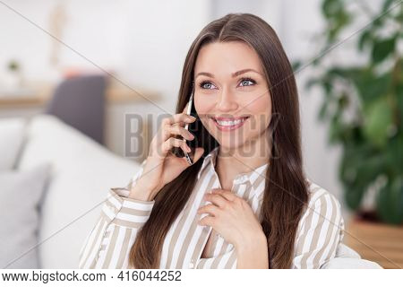 Photo Portrait Of Young Business Woman Talking On Mobile Phone Smiling In Formalwear Sitting On Sofa