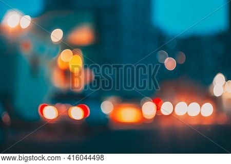 Blurred Background With Dusk Traffic Lights. Night Street Lights Out Of Focus Bokeh Background Abstr