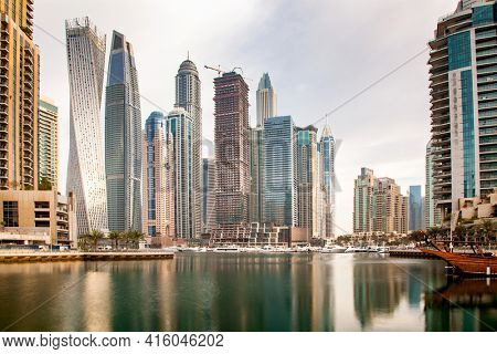 DUBAI, UAE - FEBRUARY 2018: View of modern skyscrapers shining in sunrise lights in Dubai Marina in Dubai, UAE.