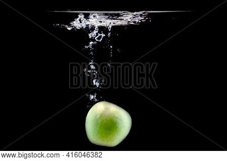 One Ripe Green Apple Fell Into The Water