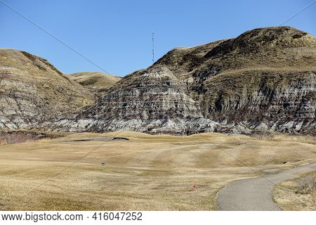 Beautiful Vistas Of A Golf Course In The Badlands Surrounded By Canyons, Hoodoos, Coulees And Mounta
