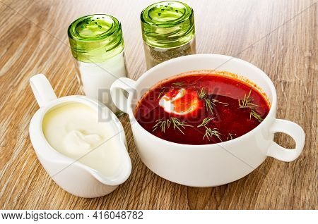 Salt And Pepper Shakers, Sauce Boat With Sour Cream, Borscht With Sour Cream And Dill In White Bowl
