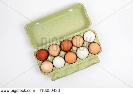 Egg Box With Organic, Free Range Chicken Eggs In Different Colors. White, Brown And Dark Brown Eggs.