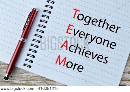 Pen And Notebook Written With Text Together Everyone Achieves More