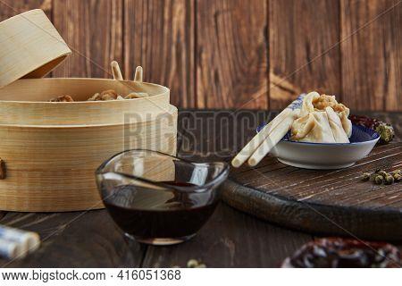 Shumai Shaomai Chinese Meat Dumpling Steamed Dish In Bamboo Steamer Box. Chopsticks And Dimsum.