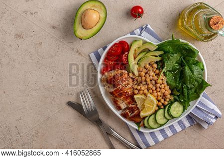 Dietary Salad With Chicken, Avocado, Cucumber, Tomato And Spinach