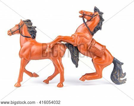 A Pair Of Brown Horses With Black Mane On A White Background.