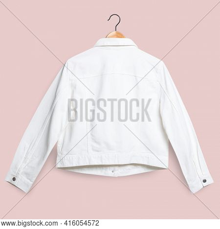 White denim jacket rear view streetwear fashion