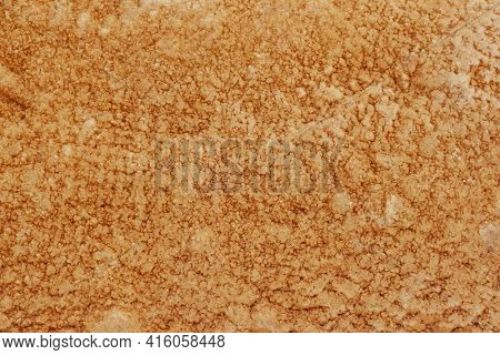 Textured Of Gold Cement Wall Is Uneven Is Design And Concept For Background.