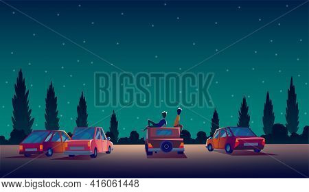 Car Street Cinema. Drive-in Theater With Automobiles Stand In Open Air Parking At Night. Cinema Nigh