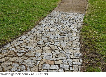 Granite Natural Paving Of Irregular Shape, Brown Gray Paving In The Pedestrian Zone In Park Near The