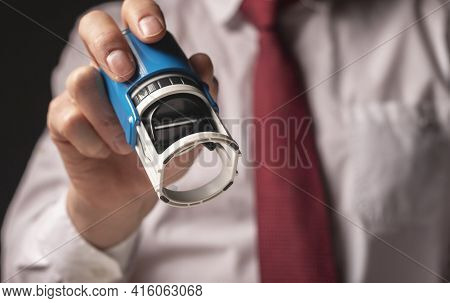 Man Holding Rubber Stamp Close Up. Businessman Certify Documents