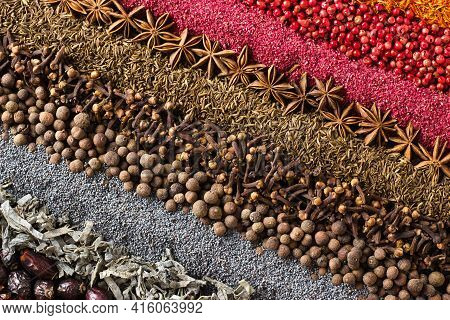 Collection Of Condiments Scattered On The Table. Spice Background For Label Decoration