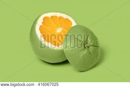 Weird Lime Colored Sliced Orange Isolated On A Pink Background