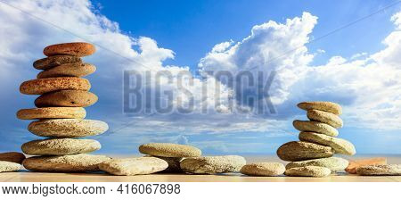 Zen Stones Stack On Blue Sky And Sea Background