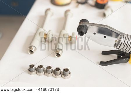 Soldering Iron For Polypropylene With Polypropylene Pipe With Tap On White Table