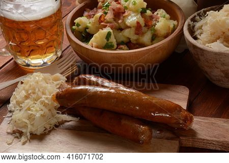 Grilled Sausages With Sauerkraut. German Food. Traditional Snack