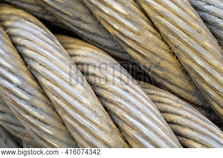 Close-up Spiral Of Giant Sling Wire Cable With Detail And Texture Background