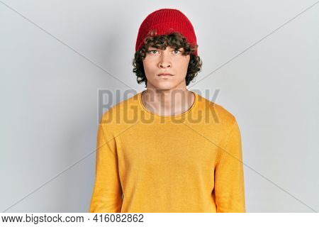 Handsome young man wearing wool hat skeptic and nervous, frowning upset because of problem. negative person.