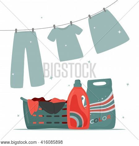 Laundry Basket With Dirty Clothes, Detergent And Washing Powder On The Table. Drying Laundry. Laundr