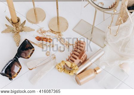 Modern Summer Accessories. Golden Jewellery, Sunglasses, Hair Clips, Cosmetics, Perfume And Lace Lin
